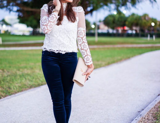 A Glam Lifestyle blogger wearing AG velvet legging jeans with Chicwish lace blouse and YSL monogram clutch
