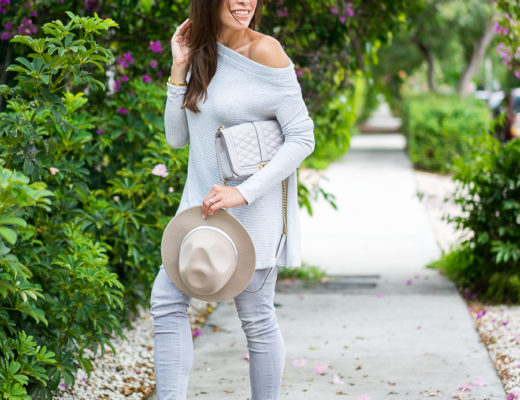 A Glam Lifestyle blogger wearing grey Free People sweater with Club Monaco fedora and Sam Edelman Petty booties