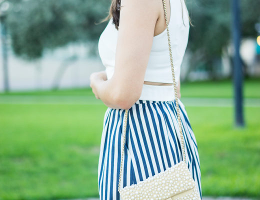 White crop top, striped skirt, Chanel pearl bag
