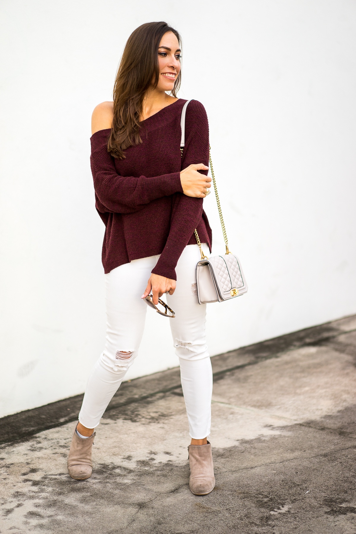 20c646846 A Glam Lifestyle fashion blogger wearing Free People slouchy sweater with  dolman sleeves and Sam Edelman