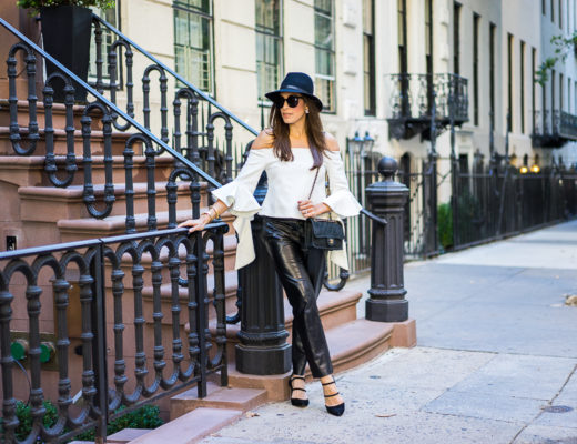 A Glam Lifestyle blogger wearing chicwish white off-the-shoulder top with milly black leather cropped pants and classic chanel bag with a rag and bone fedora and strappy-black-sandals
