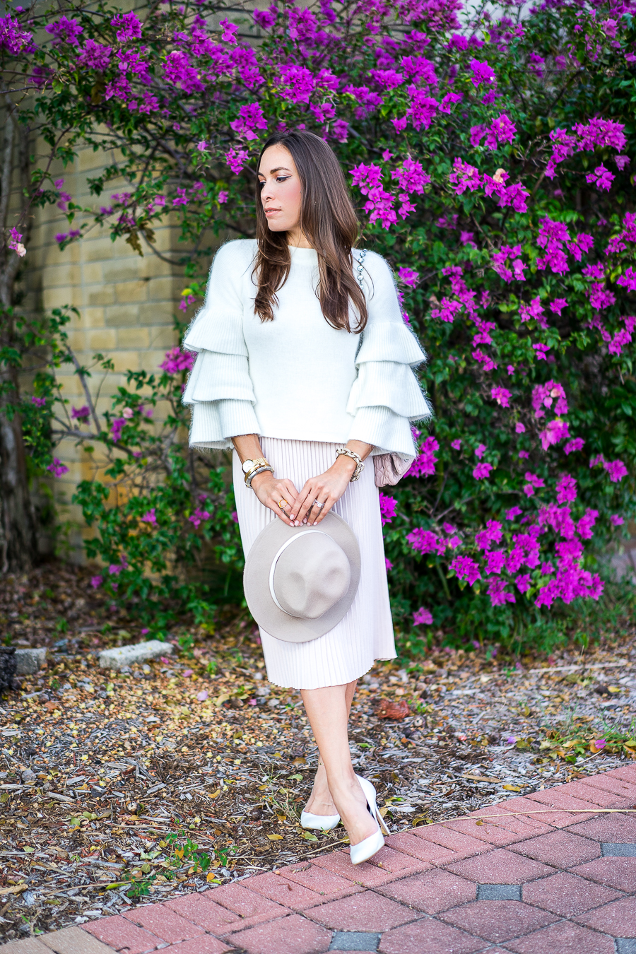 A Glam Lifestyle fashion blogger wearing Endless Rose tiered sleeve sweater and blush pleated midi skirt with Miu Miu bag and white pumps