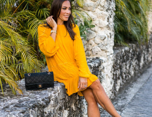 Fashion blogger Amanda from A Glam Lifestyle wears Zara mustard yellow dress with Sam Edelman burgundy velvet pumps at St Regis Bora Bora on honeymoon