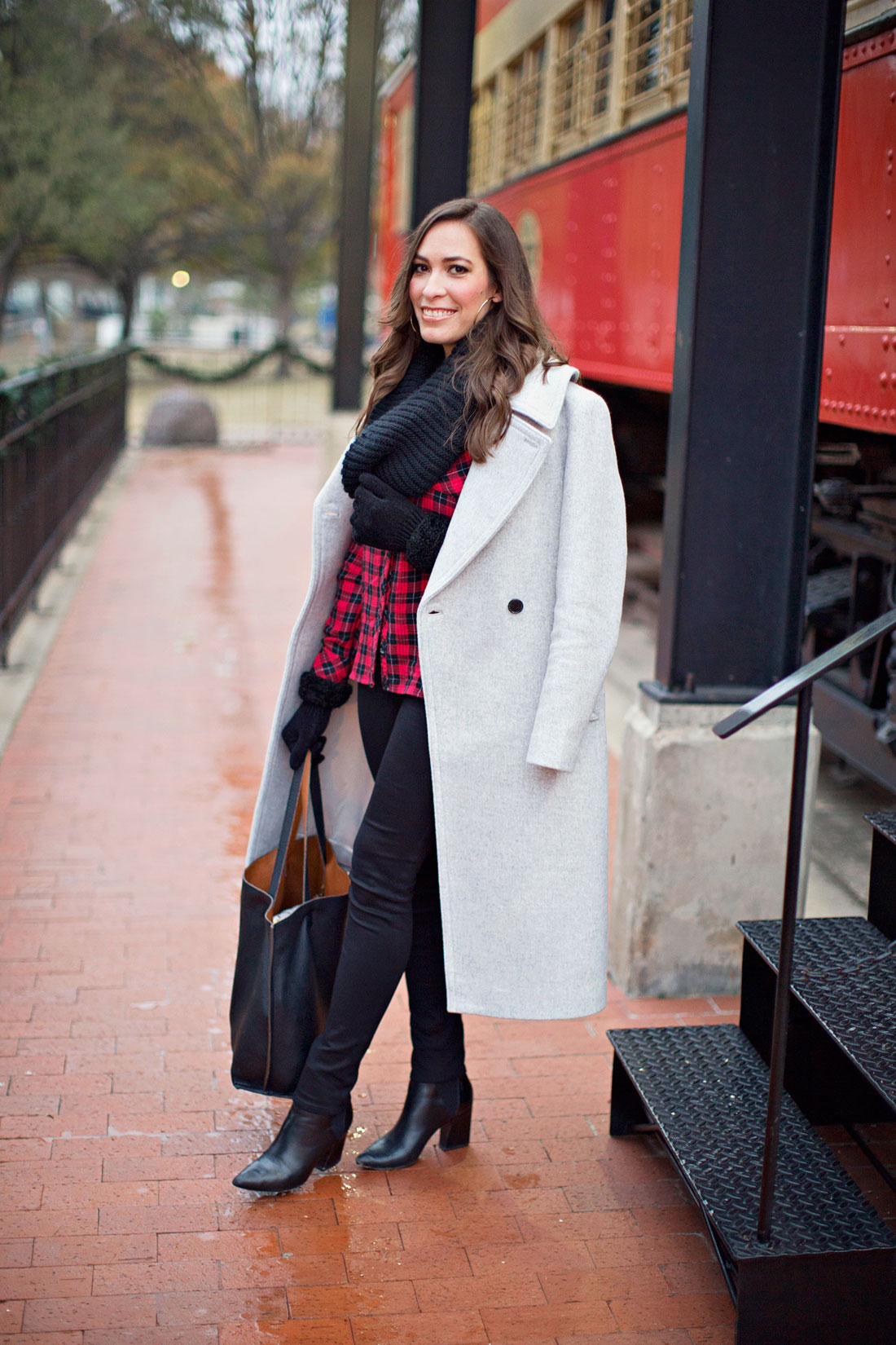 Blogger Amanda from A Glam Lifestyle wears a casual Christmas outfit in her Club Monaco Daylina coat and red buffalo plaid shirt with black infiniy scarf and ASKA Collection Troy Booties