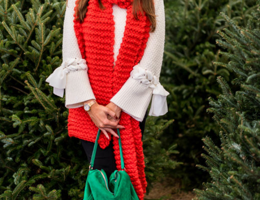 A Glam Lifestyle blogger Amanda styles an oversized red scarf with Club Monaco sweater and green suede bag