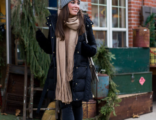 A Glam Lifestyle blogger Amanda wears her cozy JCrew wintress black puffer coat with her long Free People Kolby fringed scarf and warm JCrew grey beanie during the holidays