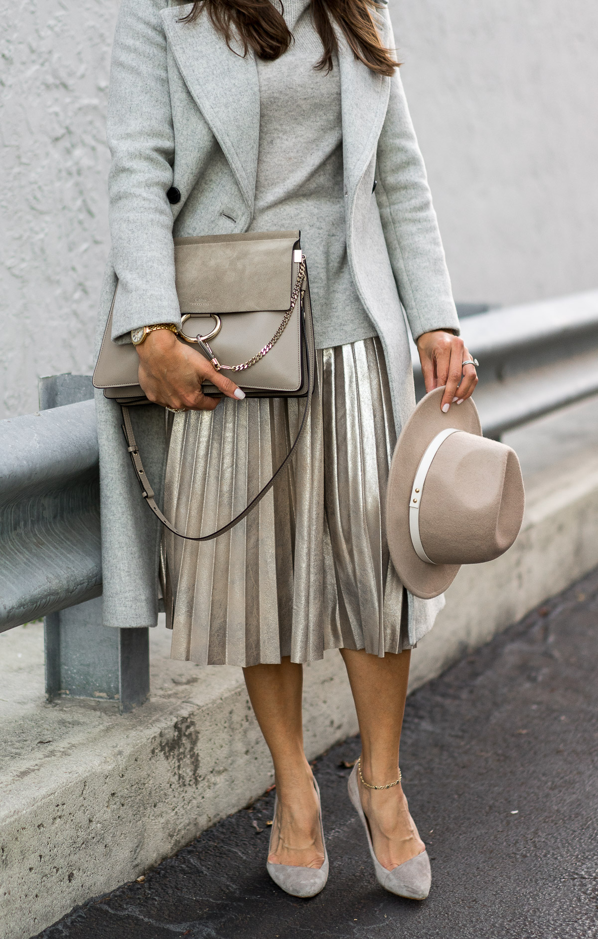 Amanda from A Glam Lifestyle blog shows how to style a gold metallic midi skirt with grey cashmere sweater and neutral accessories including Chloe Faye medium bag