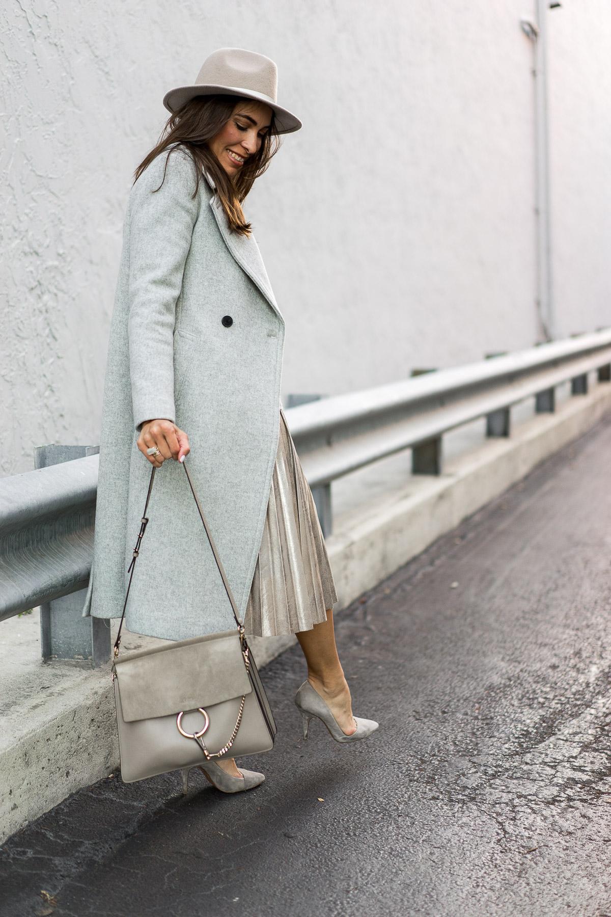 aa1cd56e5a8d5 a-glam-lifestyle-blogger-wears-club-monaco -daylina-coat-zara-gold-metallic-midi-skirt-club-monaco-fedora -chloe-faye-bag