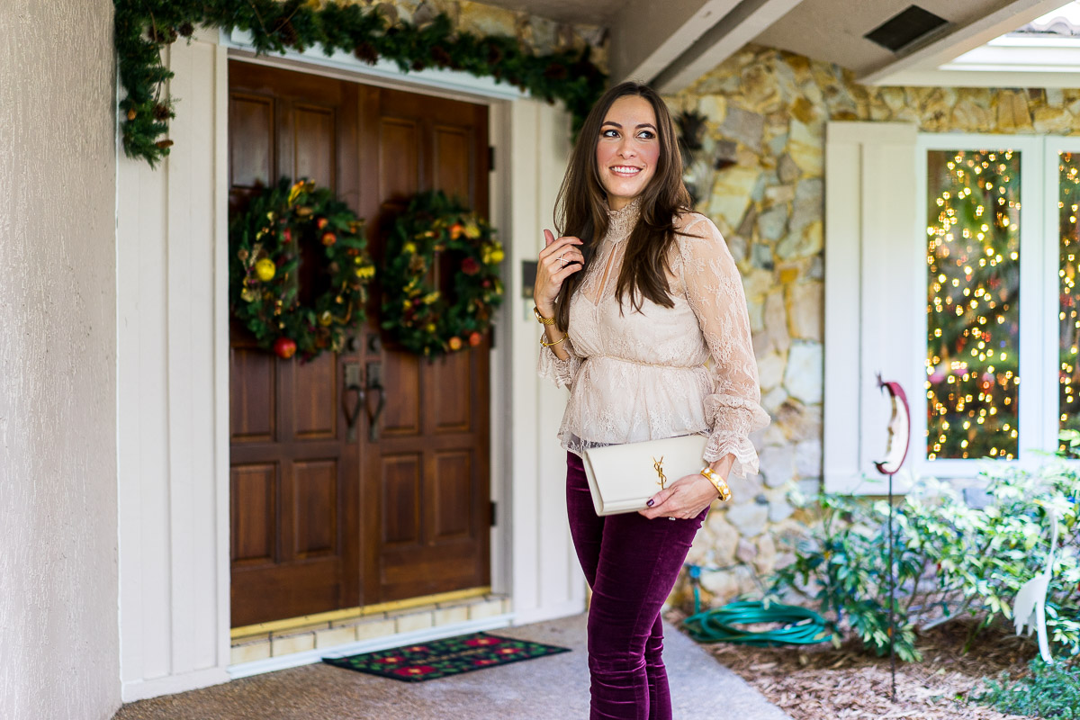 Fashion blogger Amanda from A Glam Lifestyle wears Christmas outfit of Intermix Genevieve blush lace top with AG Jeans burgundy velvet leggings and accessorized with gold Julie Vos Siena bangle