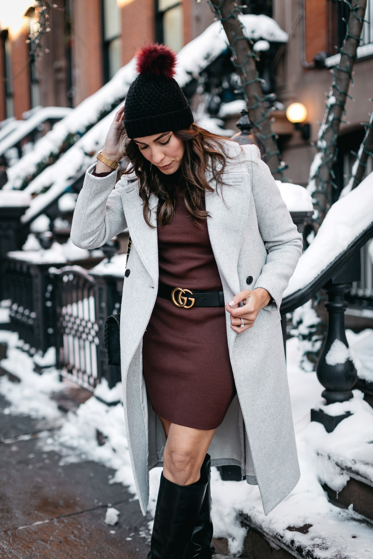 Blogger Amanda from A Glam Lifestyle wears burgundy sweater dress accessorized with Gucci Double G belt in Greenwich Village New York City during NYFW Spring 2017