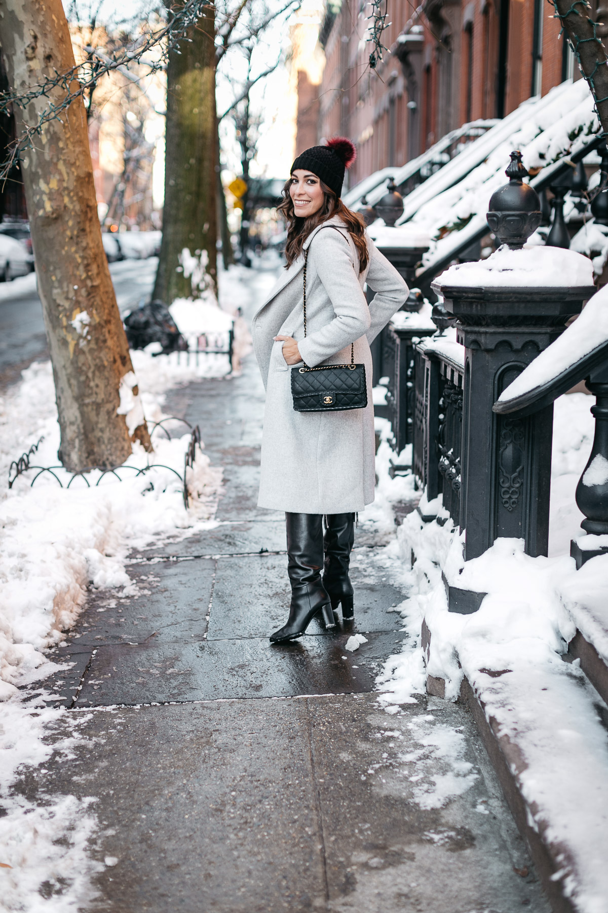 Blogger Amanda from A Glam Lifestyle wears Club Monaco Daylina coat and classic Chanel black fashion bag with MGemi Pendolo black boots