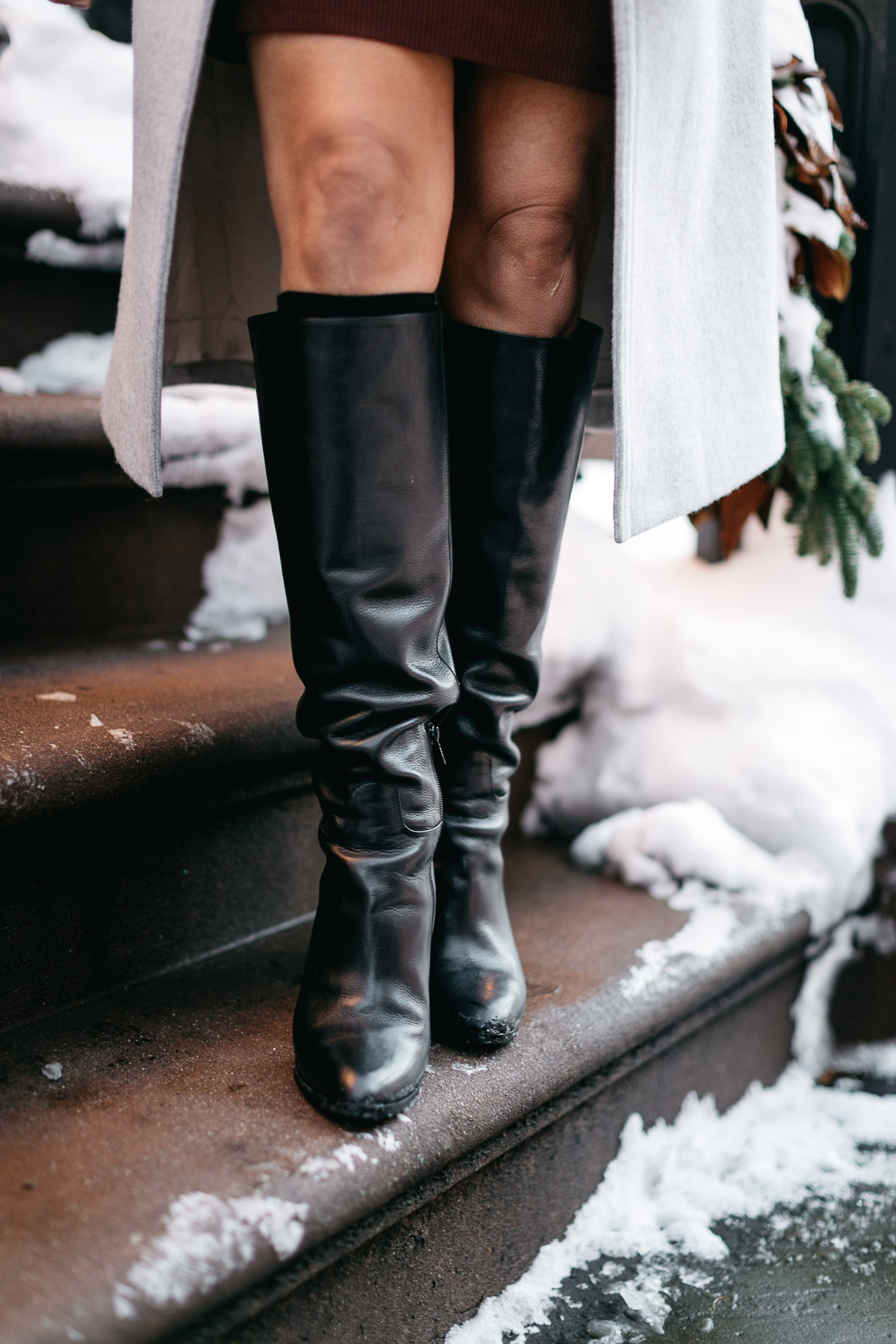 MGemi Pendolo black boots are styled by Amanda of A Glam Lifestyle blog and brings out her best NYFW street style