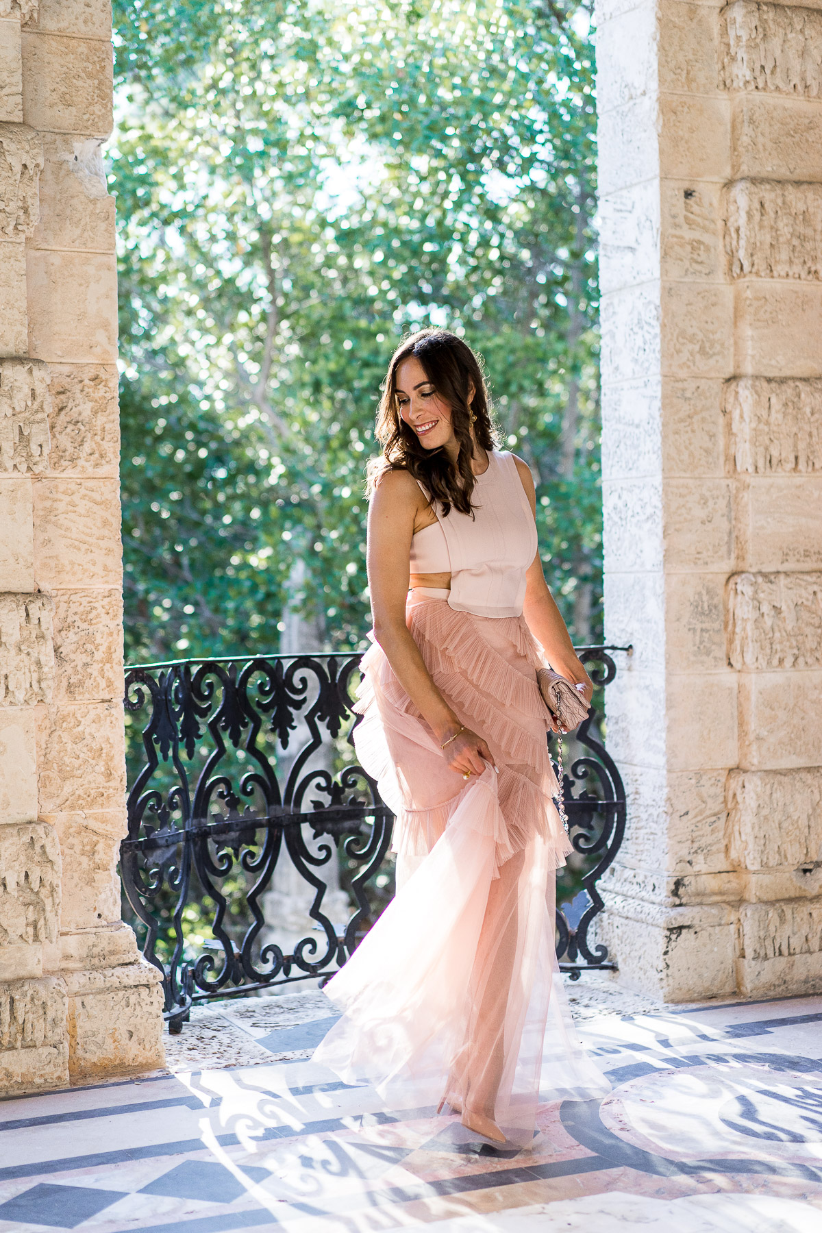 South Florida blogger Amanda from A Glam Lifestyle wears BCBG Avalon blush tulle gown at Viscaya Gardens in Miami