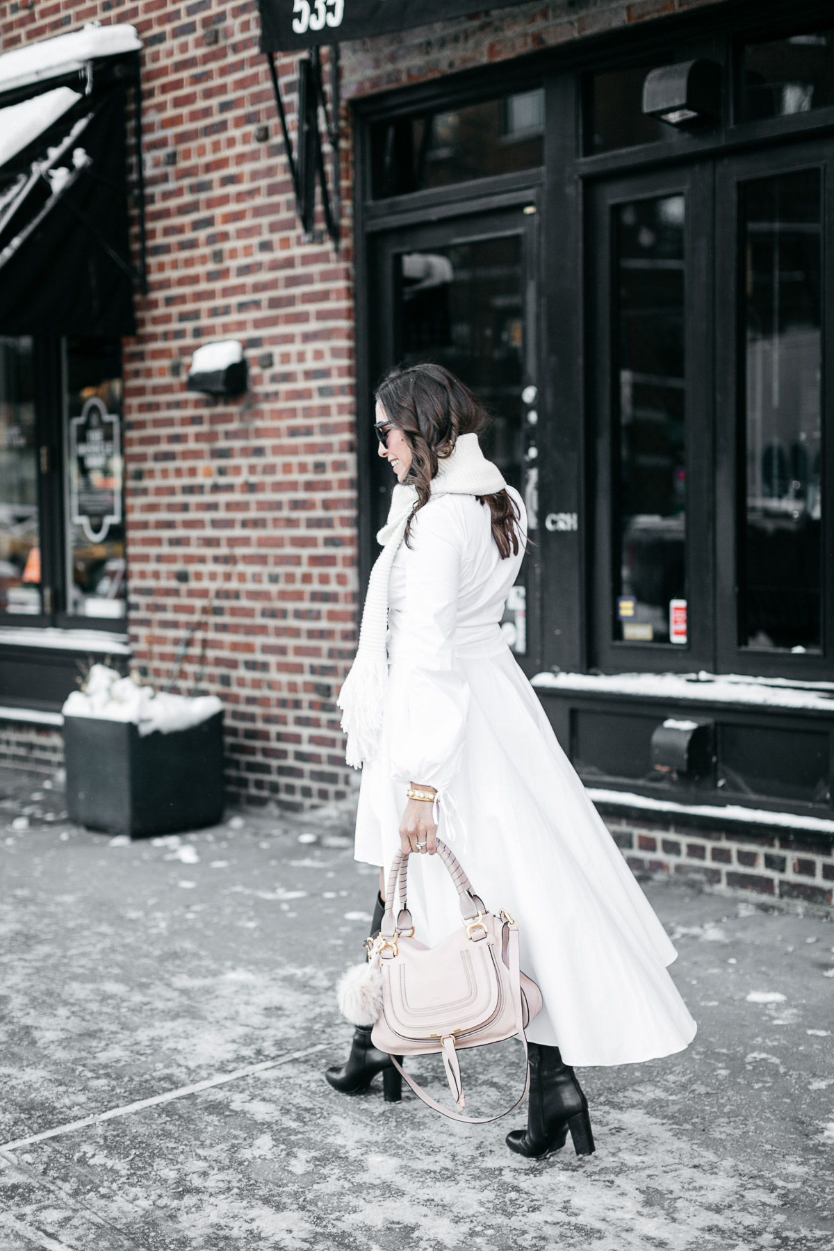 Amanda from A Glam Lifestyle blog wears Carolina Constas Lena white shirt dress in Greenwich Village during NYFW Spring 2017 while carrying Chloe Marcie bag for her NYFW street style