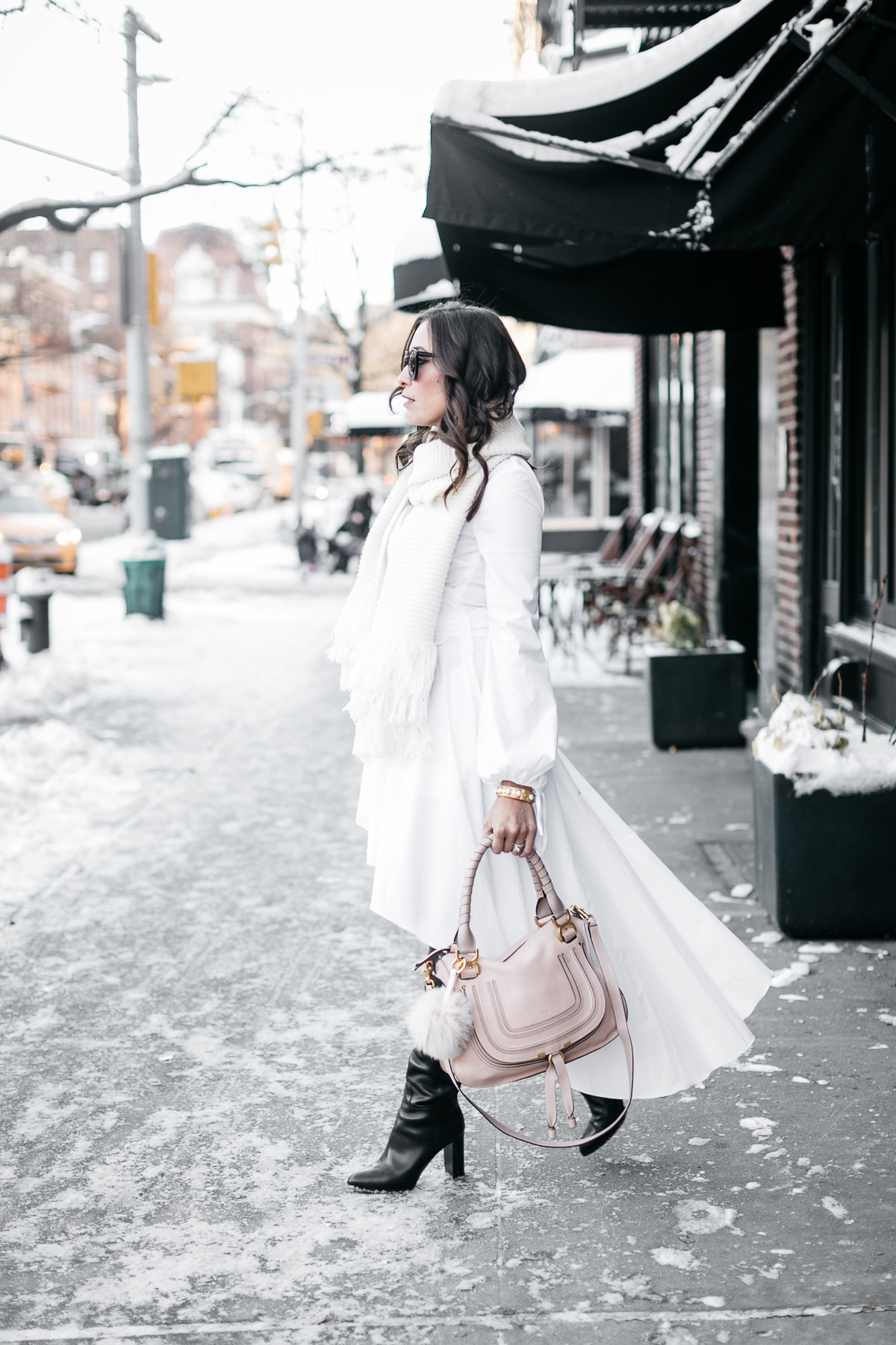 NYFW street style by Amanda of A Glam Lifestyle wearing Carolina Constas white shirt dress and Chloe Marcie bag with MGemi Pendolo boots