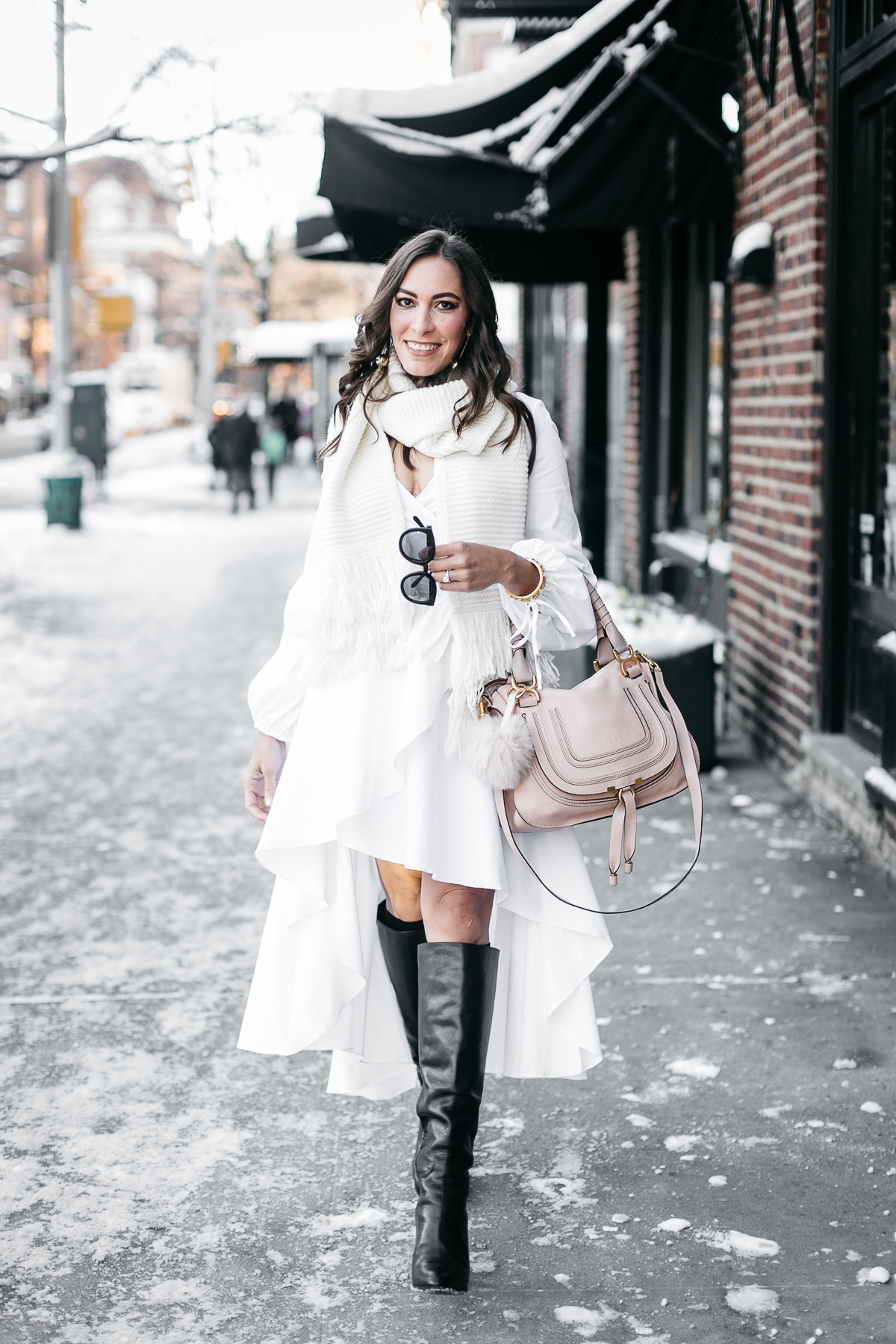 Carolina Constas white shirt dress with Kenneth Jay Lane gold ball earrings and MGemi Pendolo boots worn by Amanda from A Glam Lifestyle blog during NYFW Spring in February