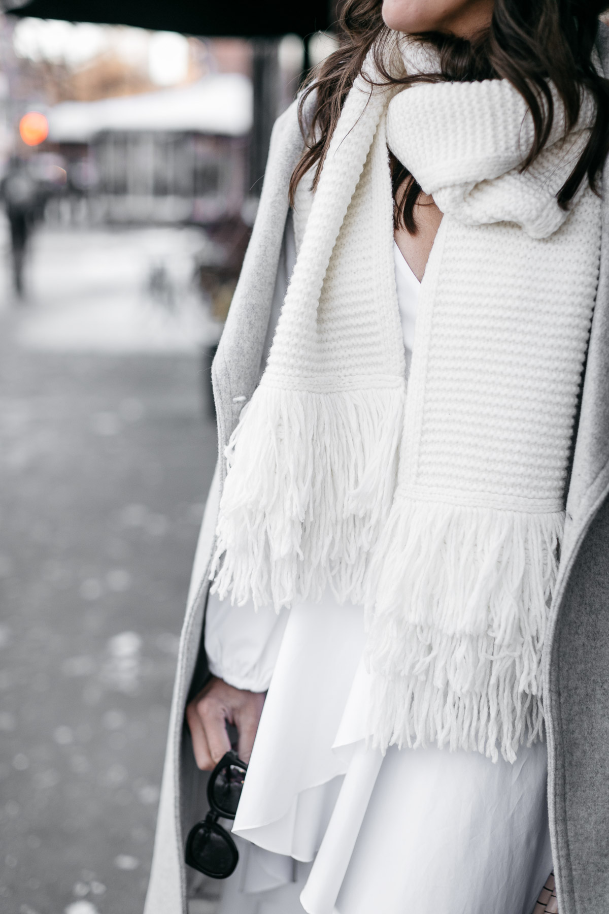 Club Monaco Juki white fringed scarf is styled by Amanda of A Glam Lifestyle blog during NYFW Spring 2017