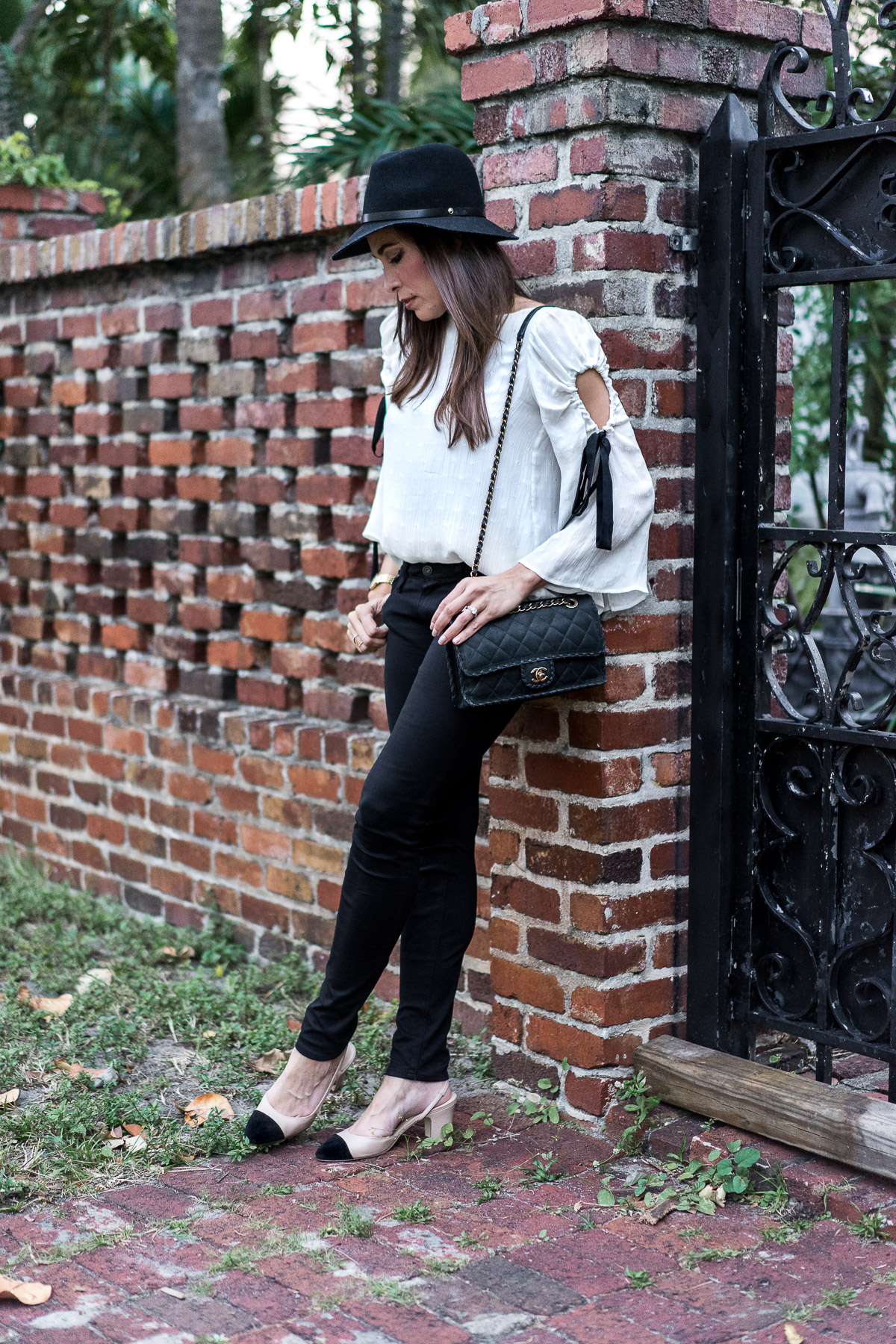Club Monaco Priyalla top worn by Amanda of A Glam Lifestyle blog with her AG black legging jeans and Ivanka Trump Liah slingback pumps