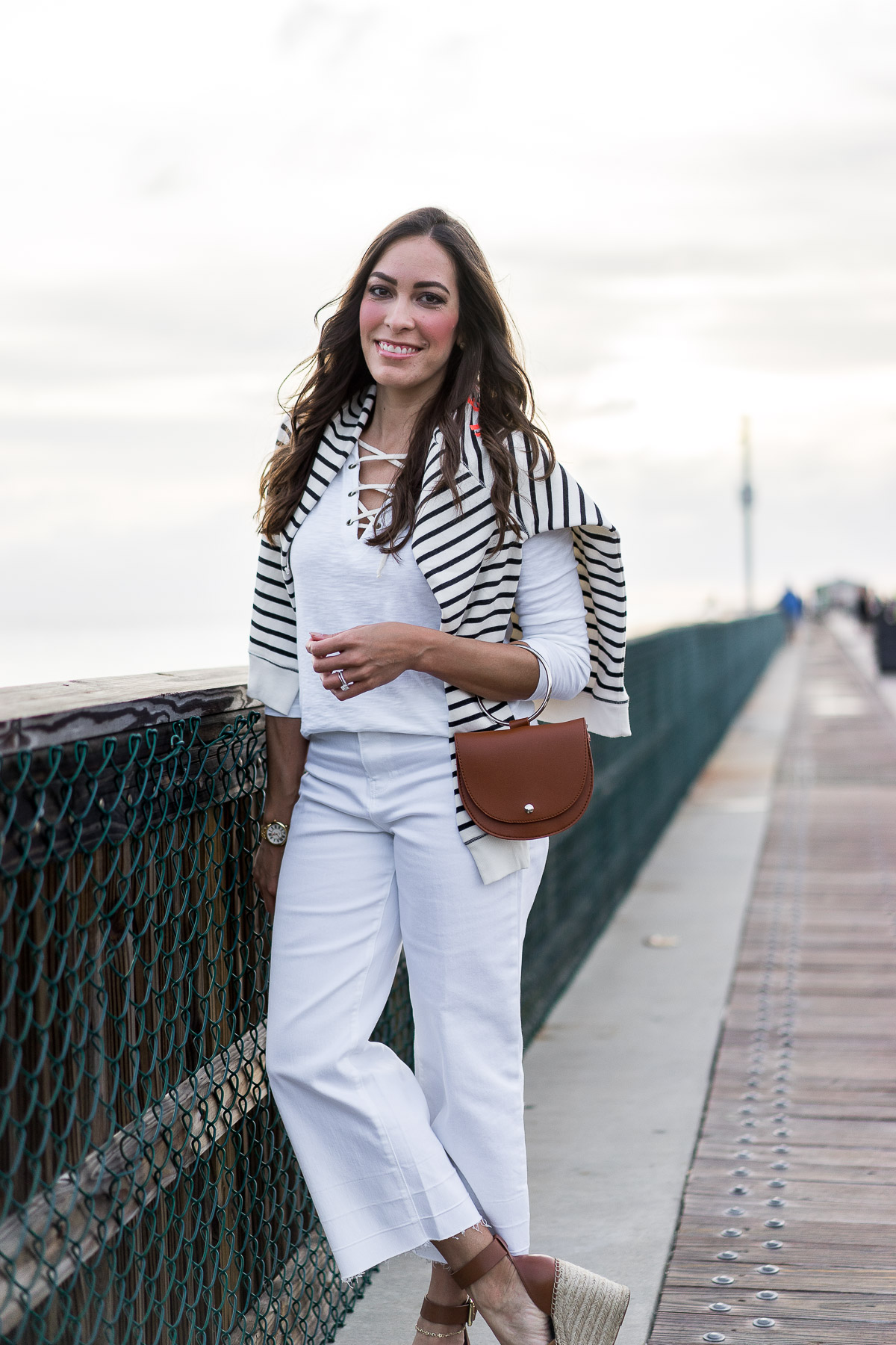Old Navy striped french terry sweatshirt is a great Spring transitional piece for neutral nautical style styled by A Glam Lifestyle blogger Amanda with Old Navy lace up tee and white wide leg denim
