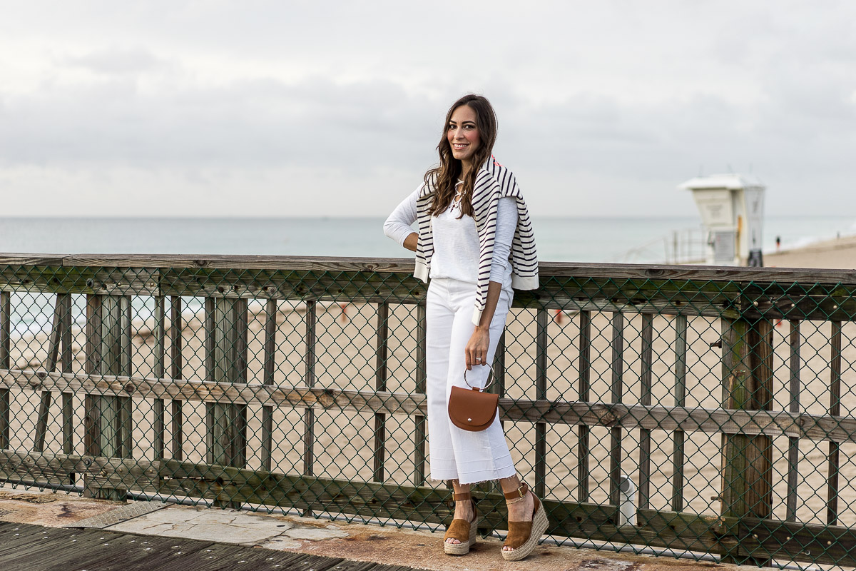 Springtime wardrobe essentials include Old Navy striped sweatshirt, Old Navy white lace up tee and high waist wide leg white denim, as styled by South Florida blogger Amanda of A Glam Lifestyle