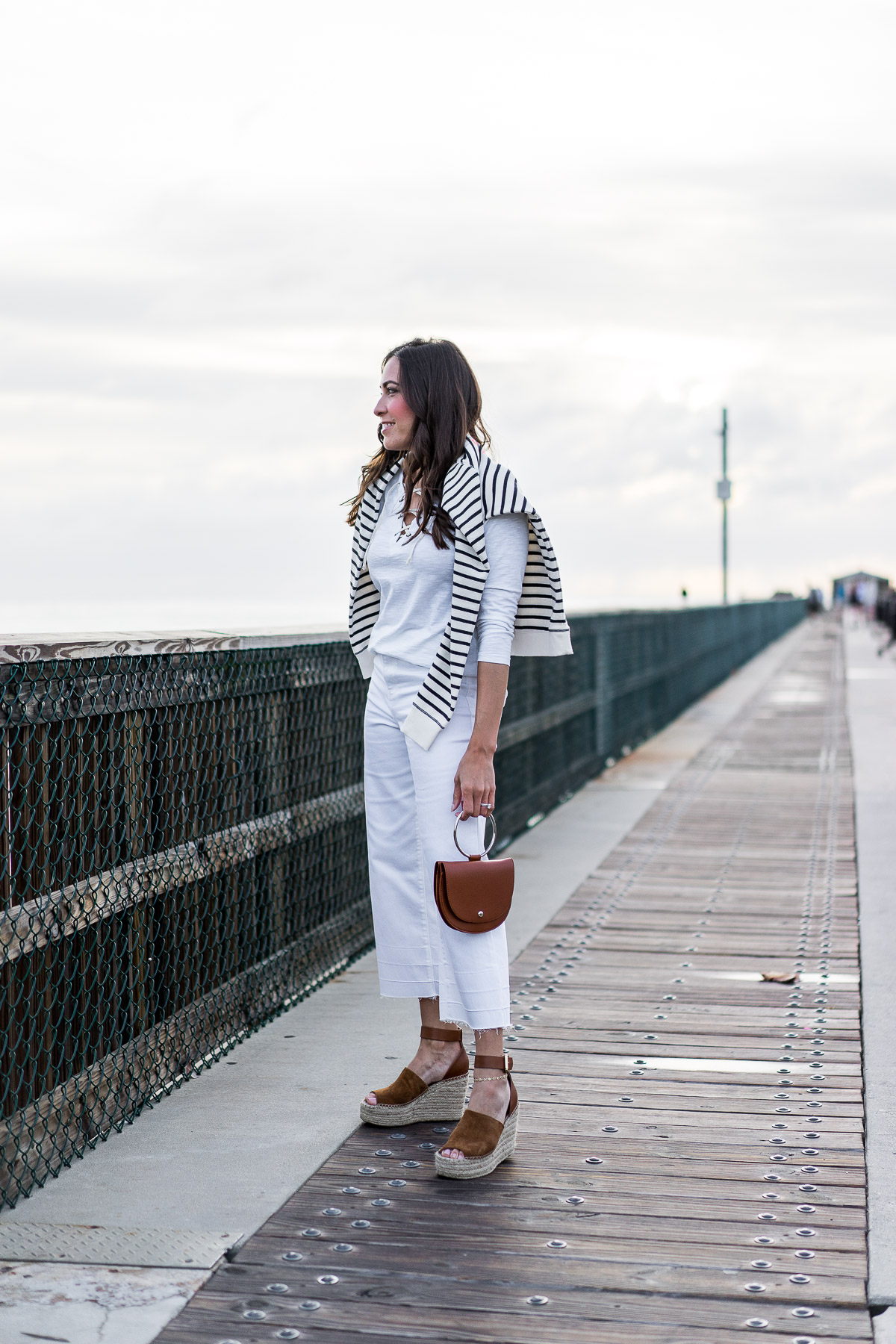 Old Navy lace up tee and Old Navy high waist white ankle jeans are styled by South Florida blogger Amanda of A Glam Lifestyle with Old Navy striped sweatshirt