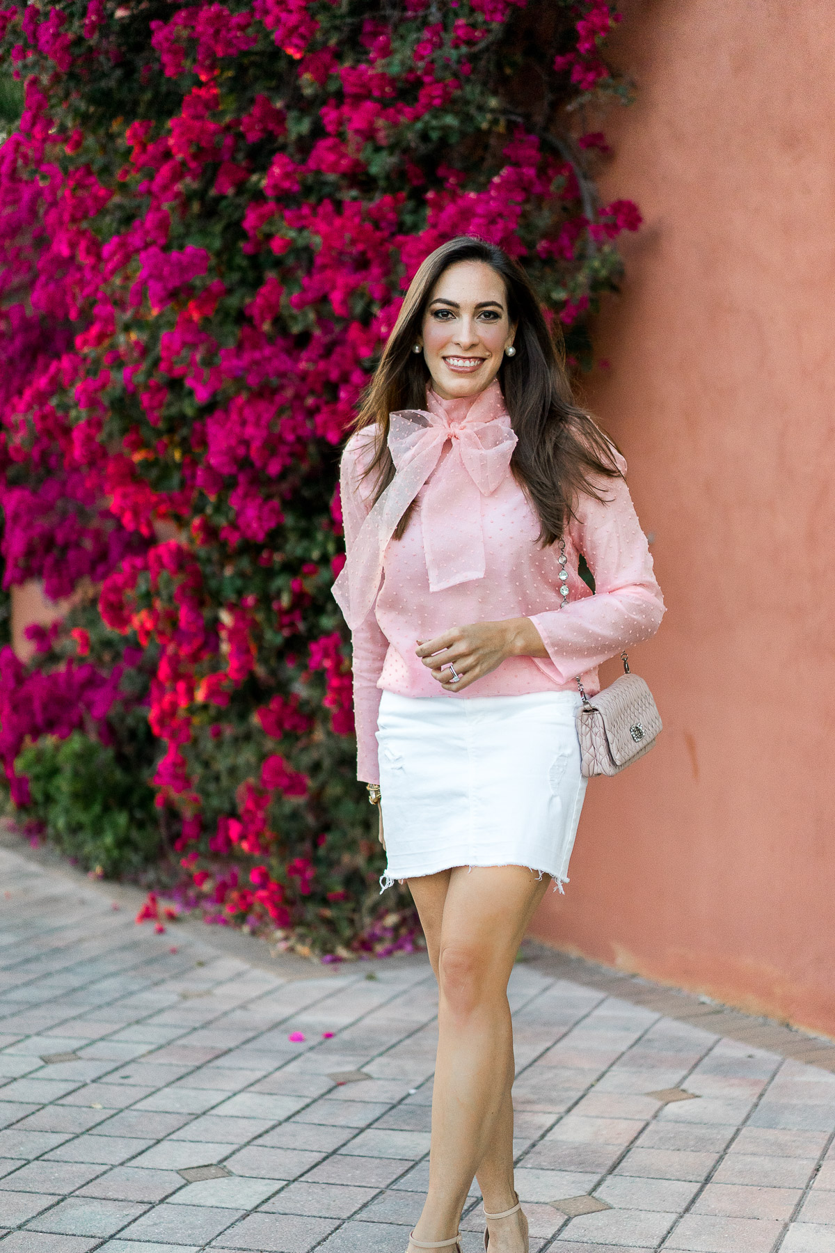 Spring style includes a pretty bow blouse as shown by Amanda from A Glam Lifestyle blog in Chicwish bow organza top and white denim skirt