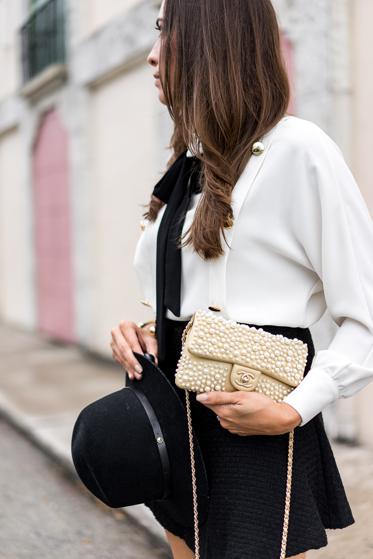 Chanel pearl bag is beautifully styled by Amanda of A Glam Lifestyle blog with Storets affordable fashion
