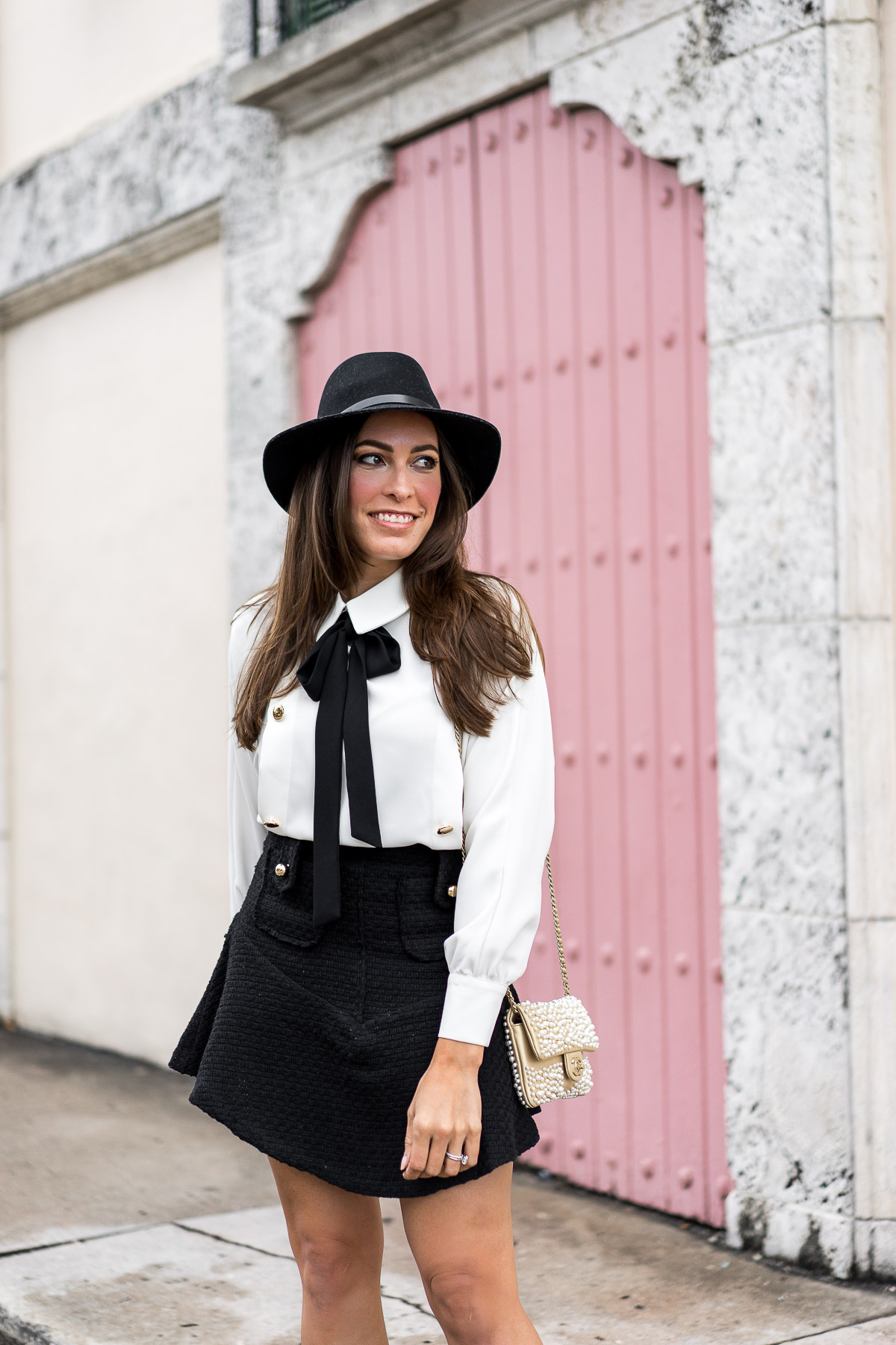 Storets offers affordable fashion like this tweed mini skirt and bow tie shirt worn by blogger Amanda from AGlamLifestyle