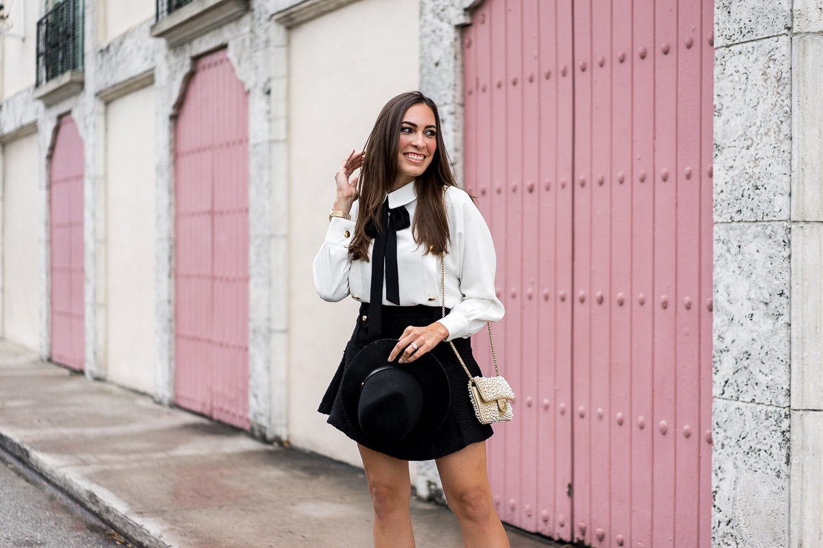 Storets school girl look with black tweed skirt and bow tie blouse worn by Amanda of AGlamLifestyle blog at Fort Lauderdale pink door