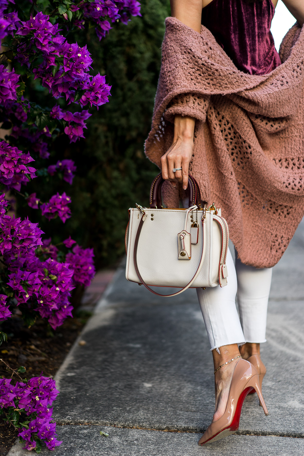 Amanda of AGlamLifestyle blog carries her Coach Rogue bag for Spring