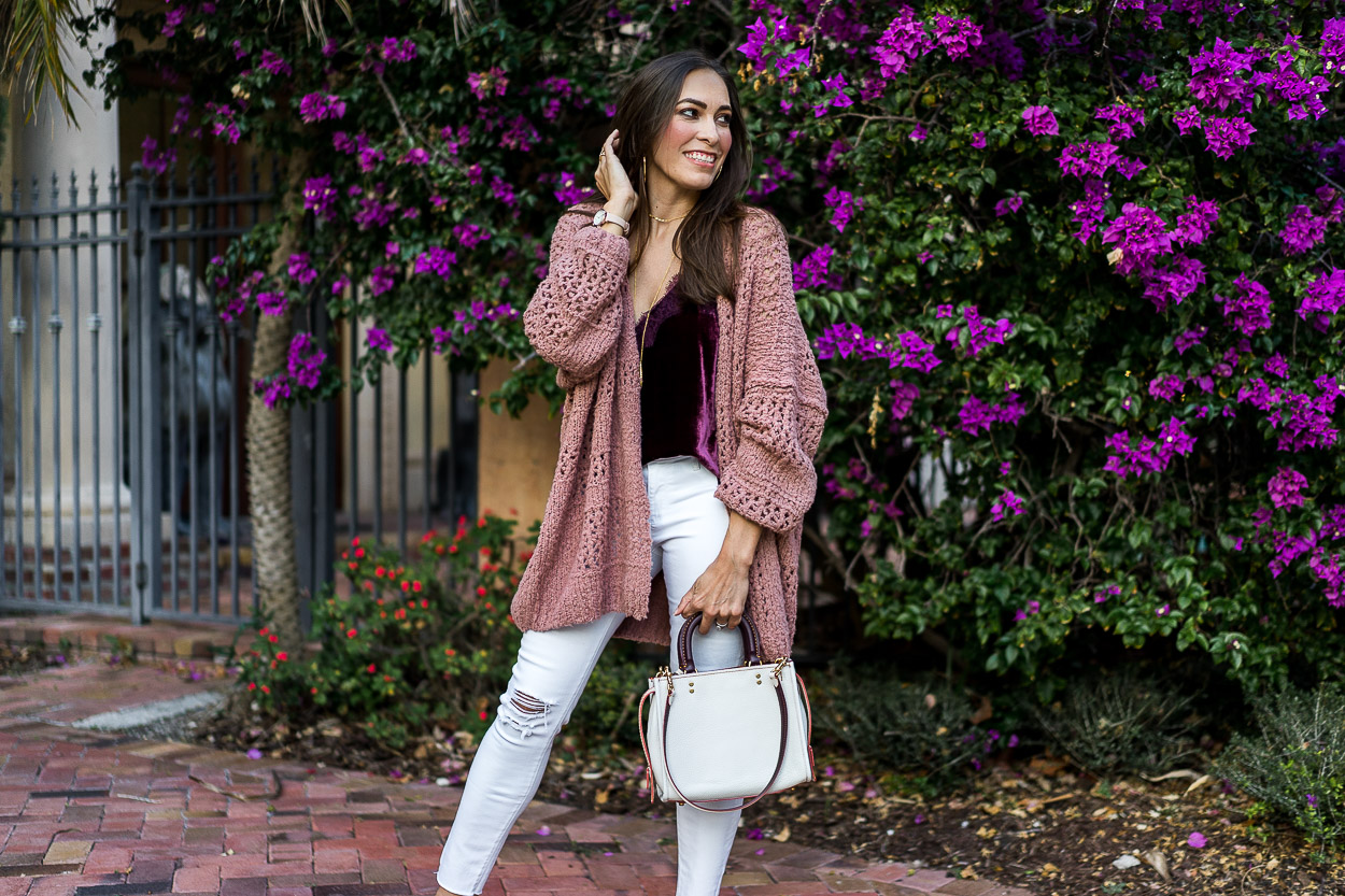 AGlamLifestyle fashion blogger Amanda carries her Coach Rogue bag to show her Spring style