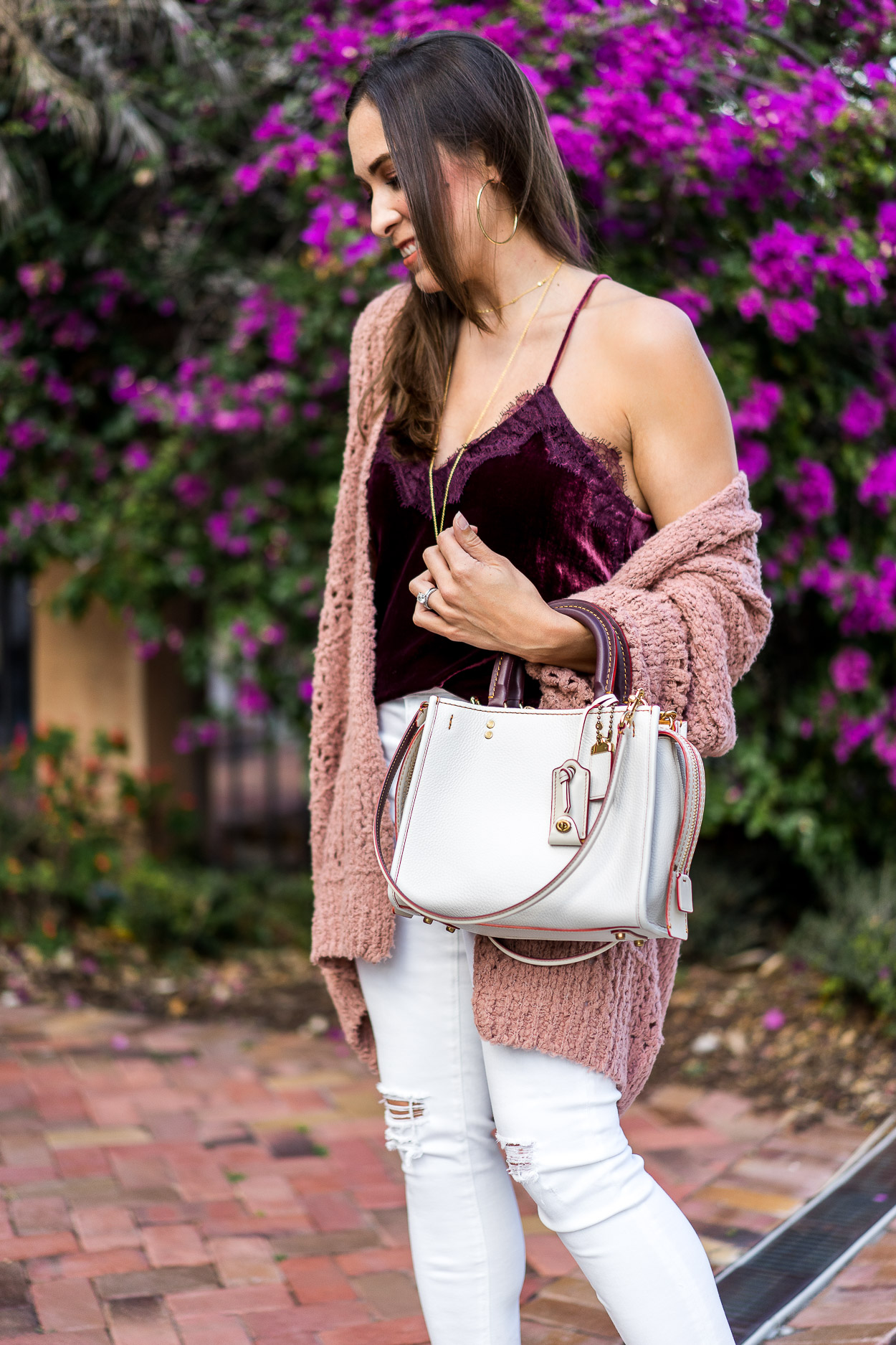 Coach Rogue bag styled with blush cardigan and velvet cami by AGlamLifestyle blogger
