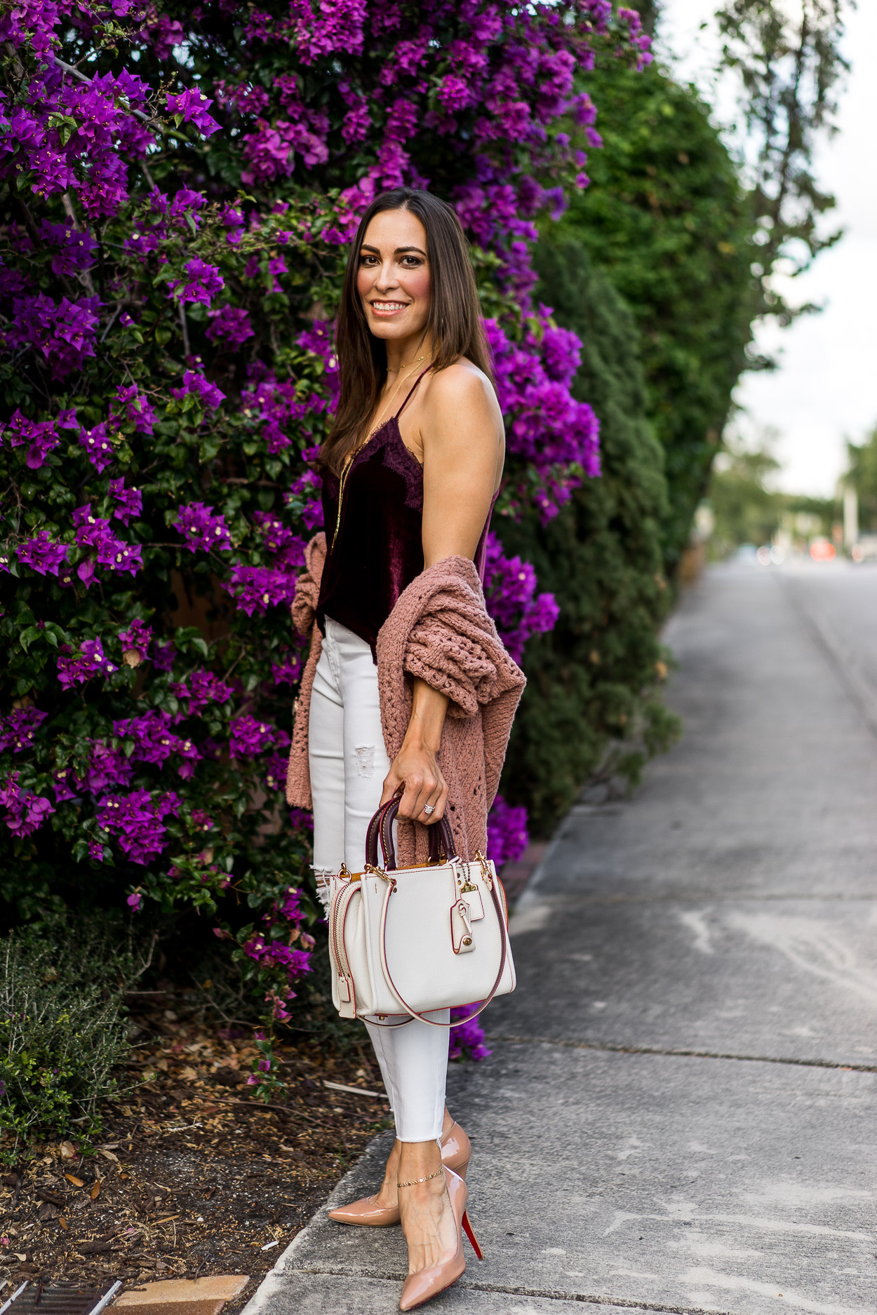 Coach Rogue bag worn by fashion blogger Amanda of A Glam LIfestyle with blush Free People cardigan and velvet cami top