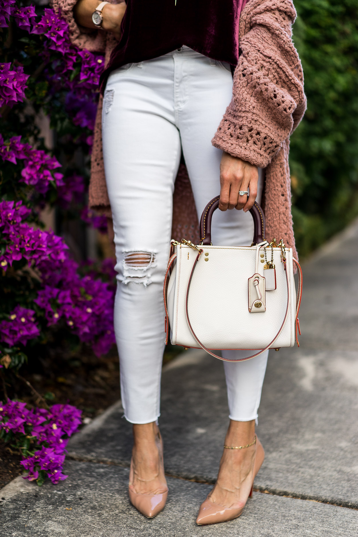 Coach Rogue pebbled leather bag worn with white distressed AG legging jeans by Amanda of A Glam Lifestyle blog