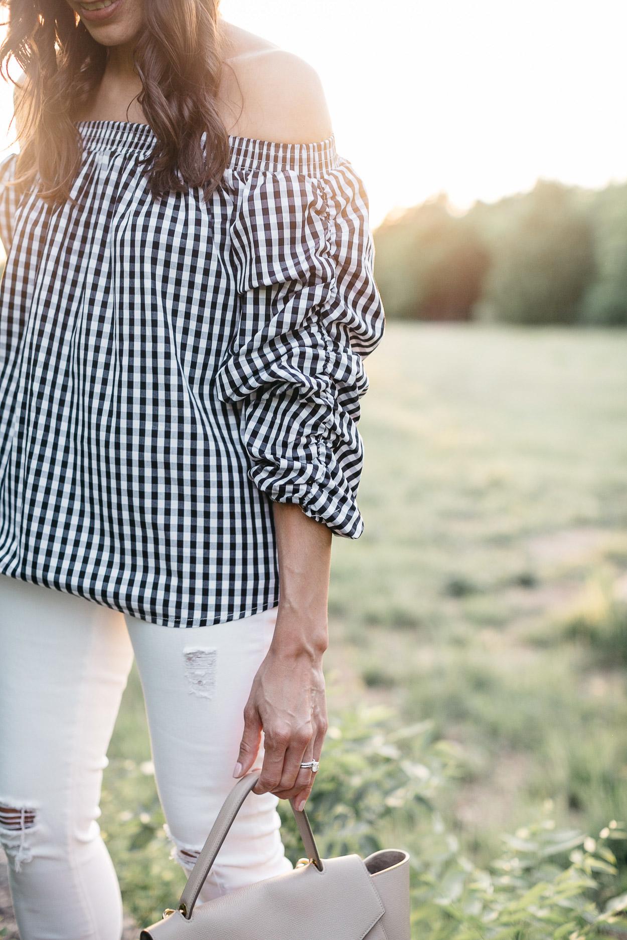 Gingham top is worn off the shoulder by Amanda of AGlamLIfestyle blog to show her Spring style