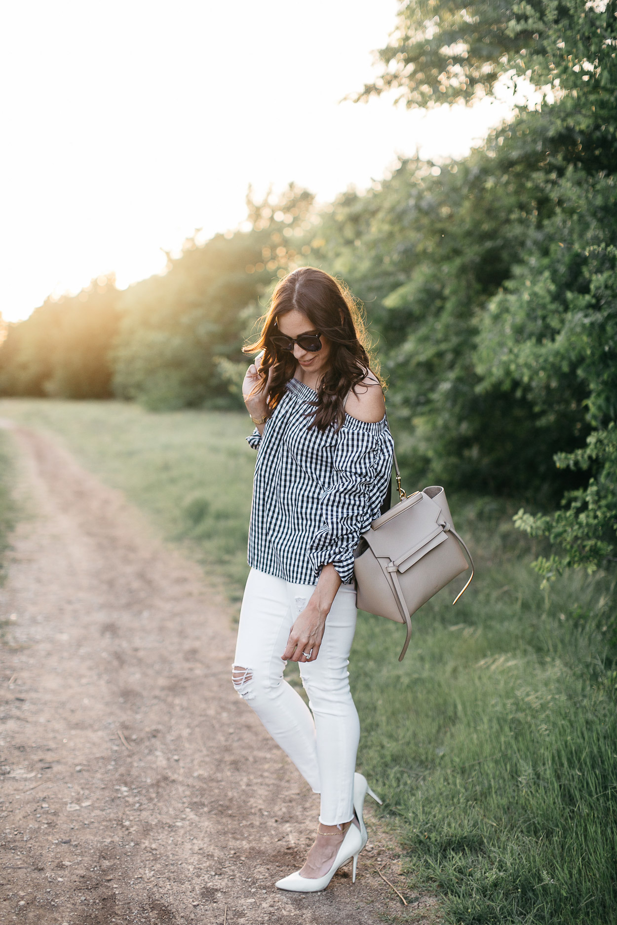 Gingham top for Spring by Chicwish worn by South Florida fashion blogger Amanda of AGlamLifestyle with Celine Belt bag and AG Jeans white legging jeans