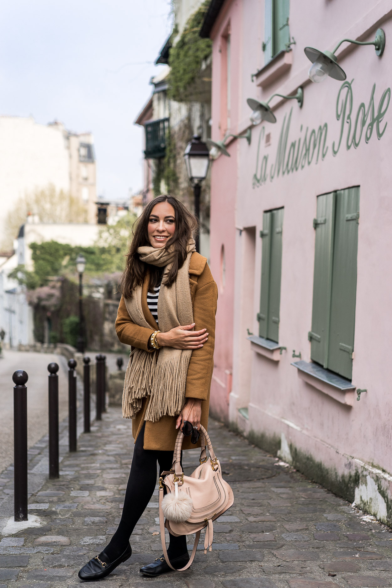 Things to do in Montmartre include dining at La Maison Rose cafe highlighted by AGlamLifestyle blogger Amanda in her tips for planning a Paris vacation