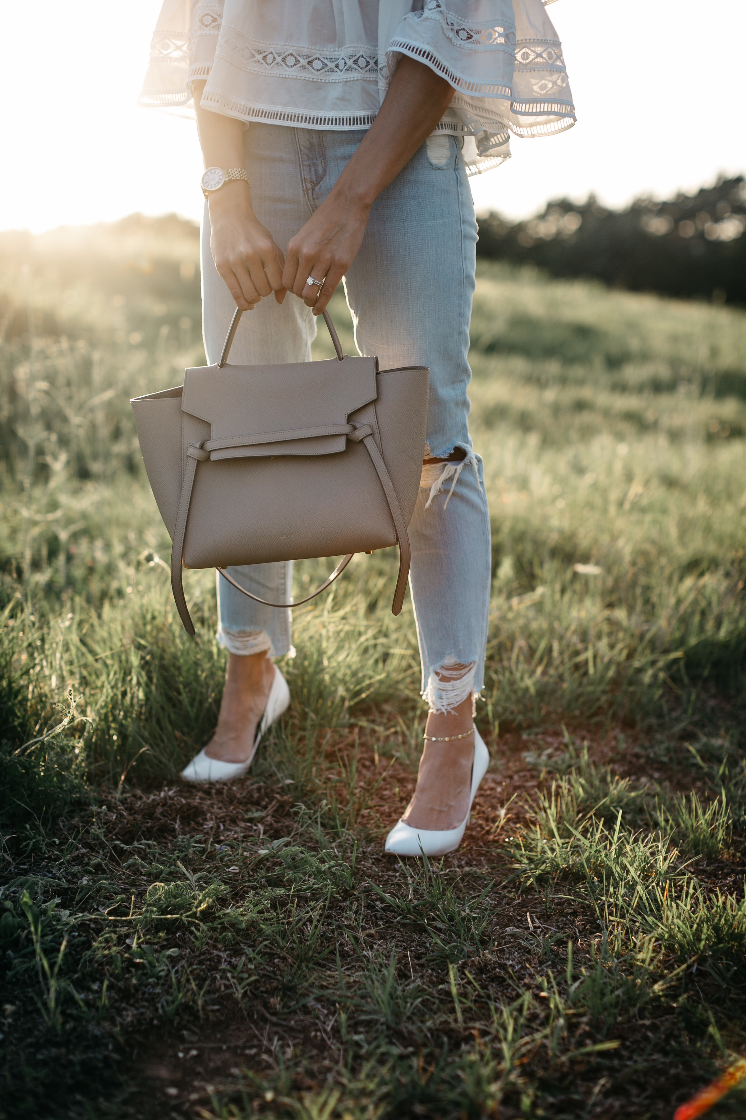 Celine belt bag worn with Lovers and Friends distressed jeans by Amanda of A Glam Lifestyle blog