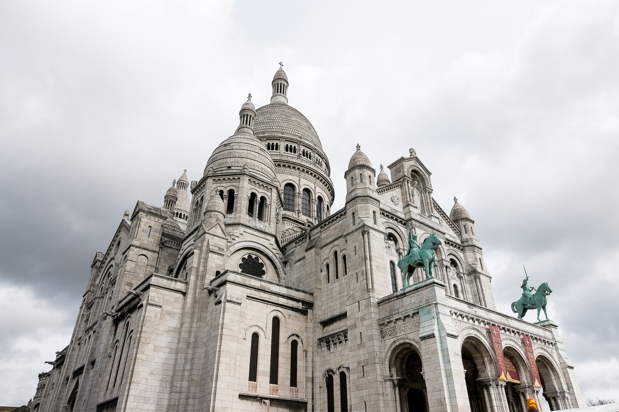 Visiting the Sacre Coeur church is one of the best things to do in Montmartre recommended by A Glam Lifestyle blogger Amanda for planning a trip to Paris