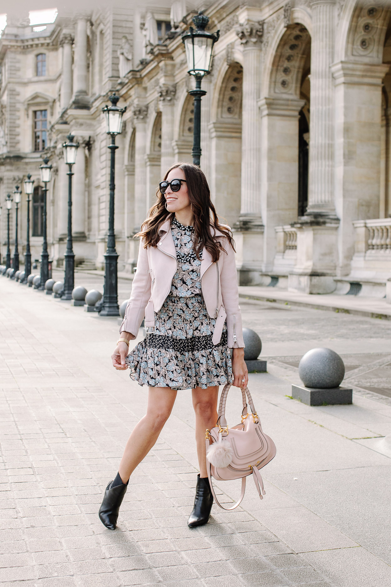 Pretty silk floral dress worn by fashion blogger Amanda of A Glam Lifestyle blog with blush moto jacket and Chloe Marcie bag at visit to Louvre Museum in Paris