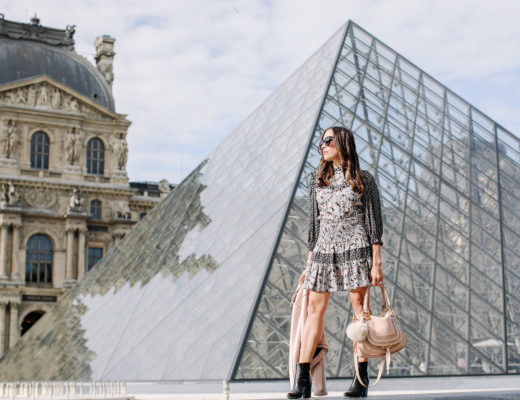 Fashion blogger Amanda wears silk floral dress at the Louvre during Paris vacation with black ASKA booties and blush moto jacket and Chloe Marcie bag