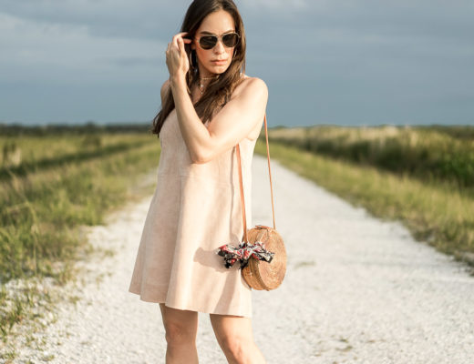 AGlamLifestyle blogger wears Free People Retro Love Suede dress for Summer with round basket bag and floral bandana