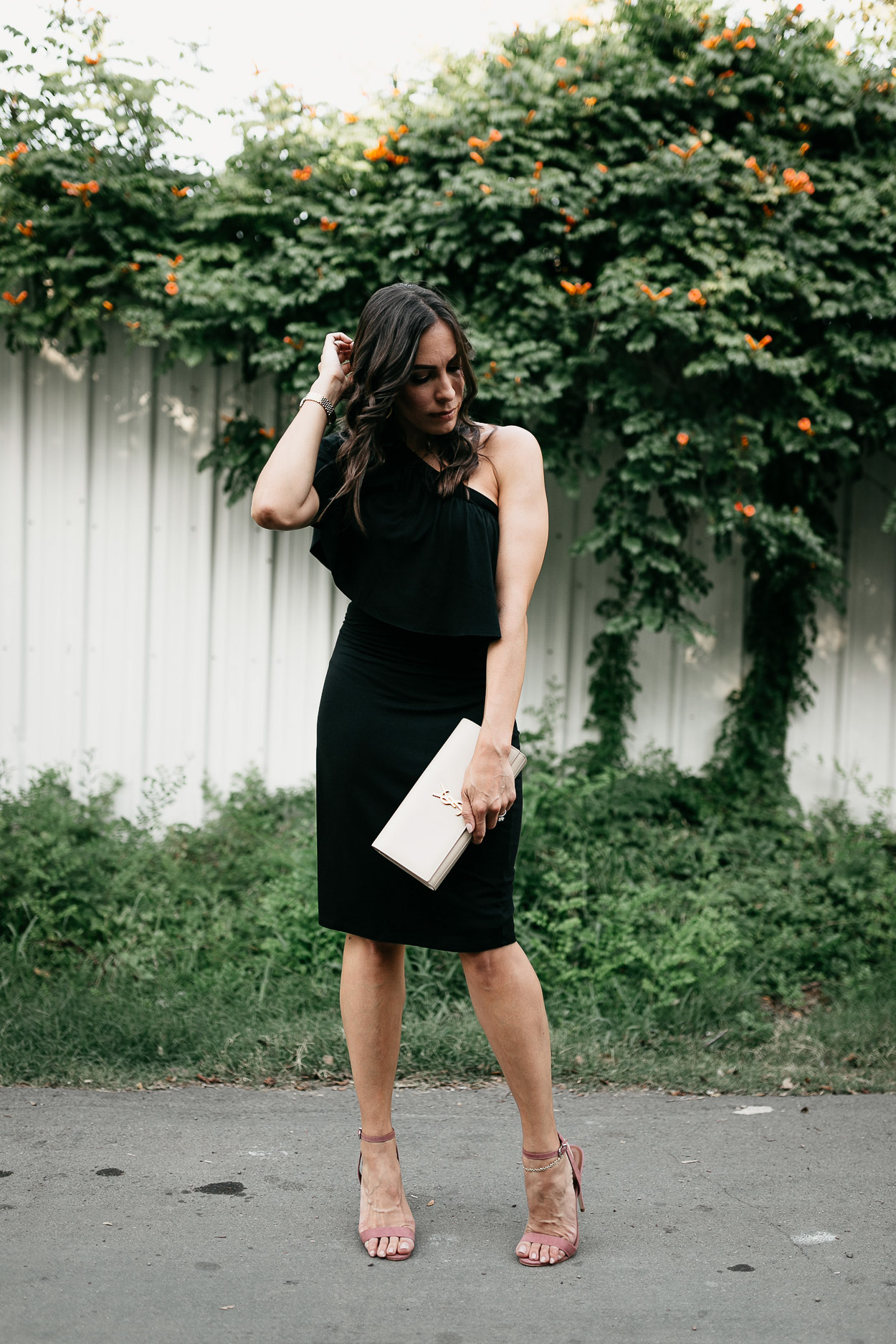 Wear a simple Three Dots black ruffle dress for your next date night as styled by A Glam Lifestyle blogger Amanda with chic details like mauve heels and nude YSL clutch