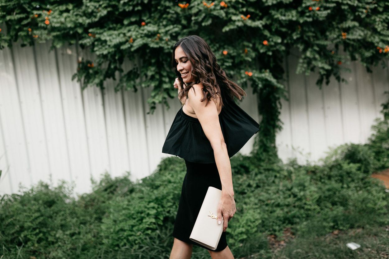 Twirl into date night with a soft black ruffle dress like this style by Three Dots worn by AGlamLifestyle blogger Amanda
