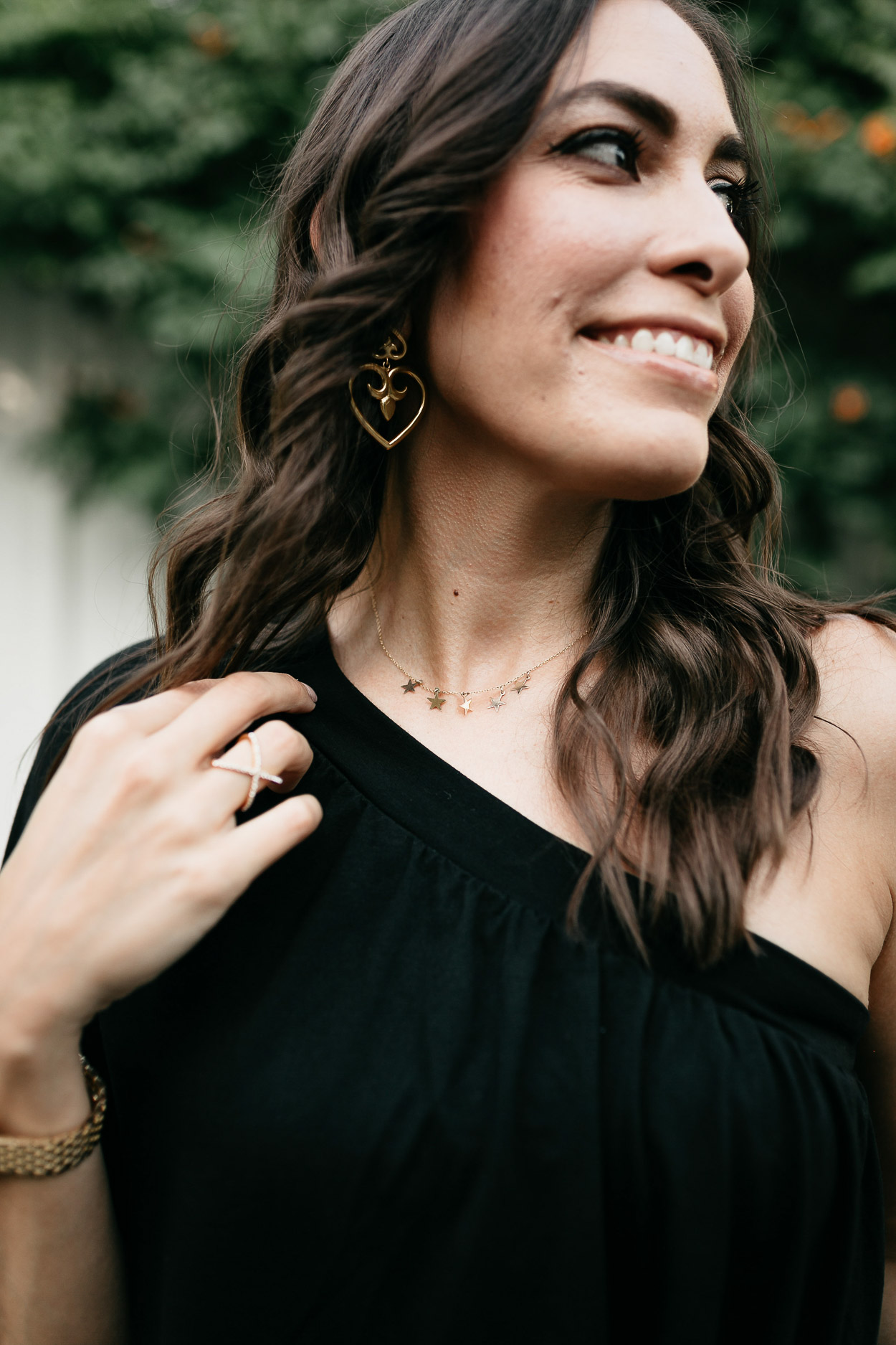 Style your black one shoulder dress with dainty gold jerelry like these Parapala Jewelry necklaces and Julie Vos earrings shown by AGlamLifestyle blogger
