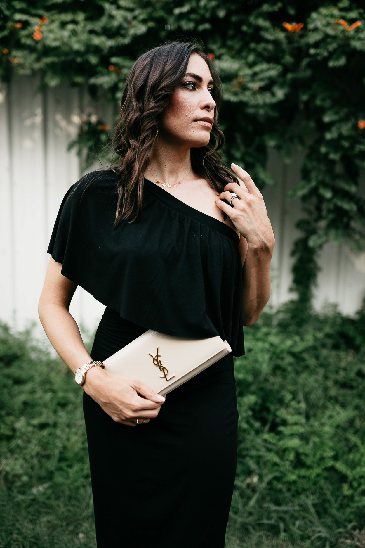 For date night, wear a classic black ruffle dress by Three Dots and compliment it with a nude YSL monogram clutch and mauve heels like fashion blogger Amanda of A Glam LIfestyle