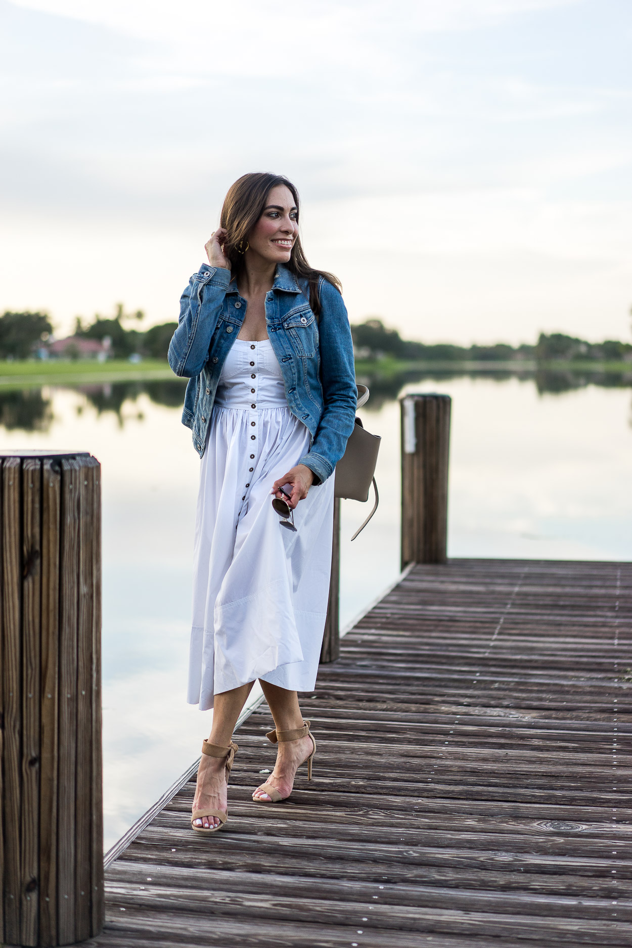 Top off your Summer white dress with a classic denim jacket by AG Jeans like blogger Amanda of A Glam Lifestyle