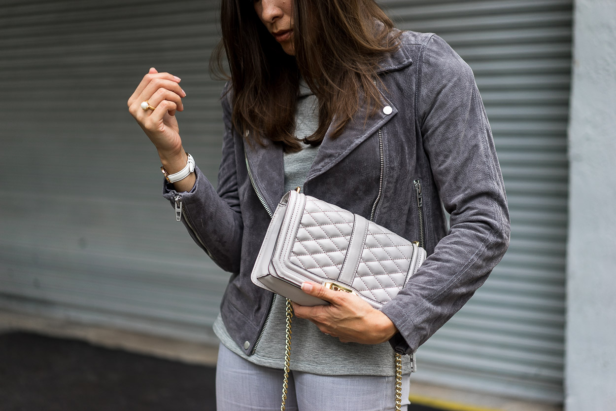 The Blank NYC grey suede jacket is a staple piece for a Fall wardrobe shown by A Glam Lifestyle blogger Amanda with her Rebecca Minkoff Love Crossbody bag as her token accessory
