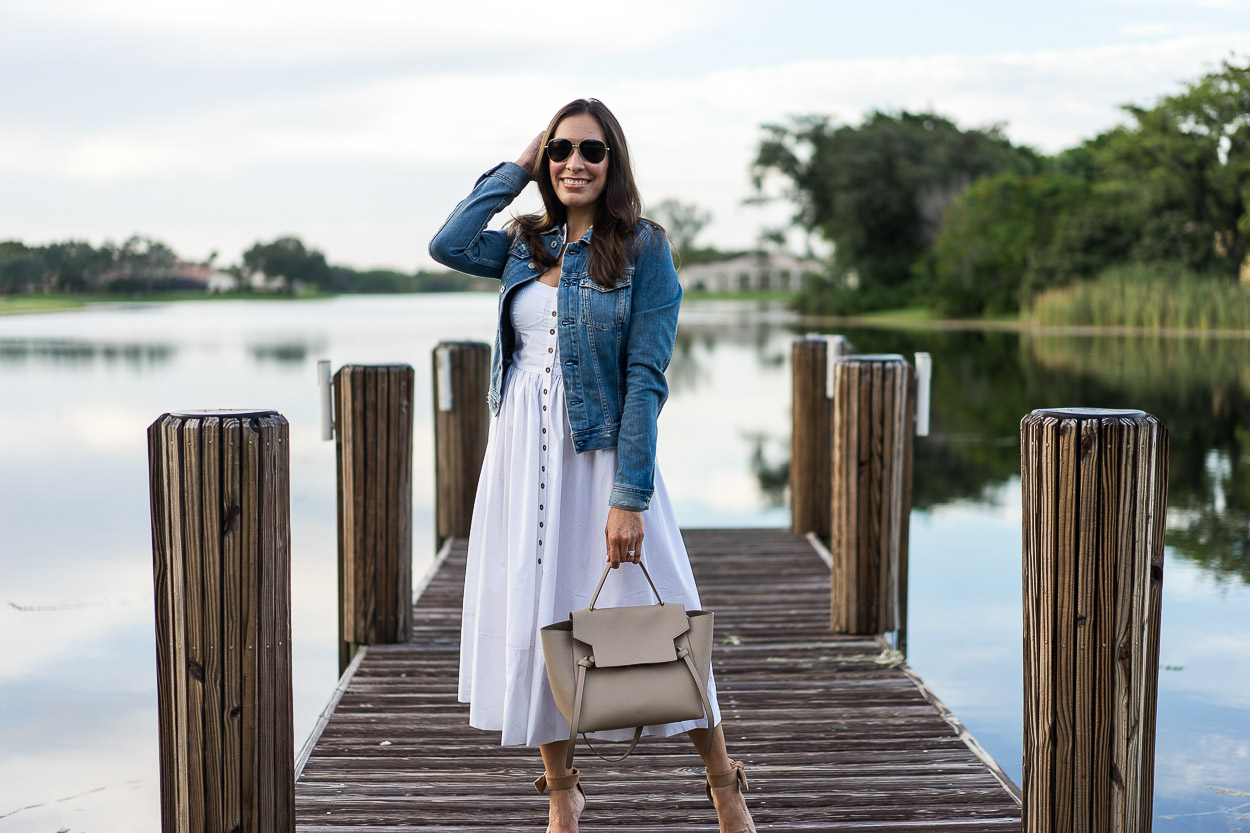 Chicwish white cami dress is styled at the lake by fashion blogger Amanda of A Glam Lifestyle with neutral accessories like Celine belt bag and Banana Republic bow heels
