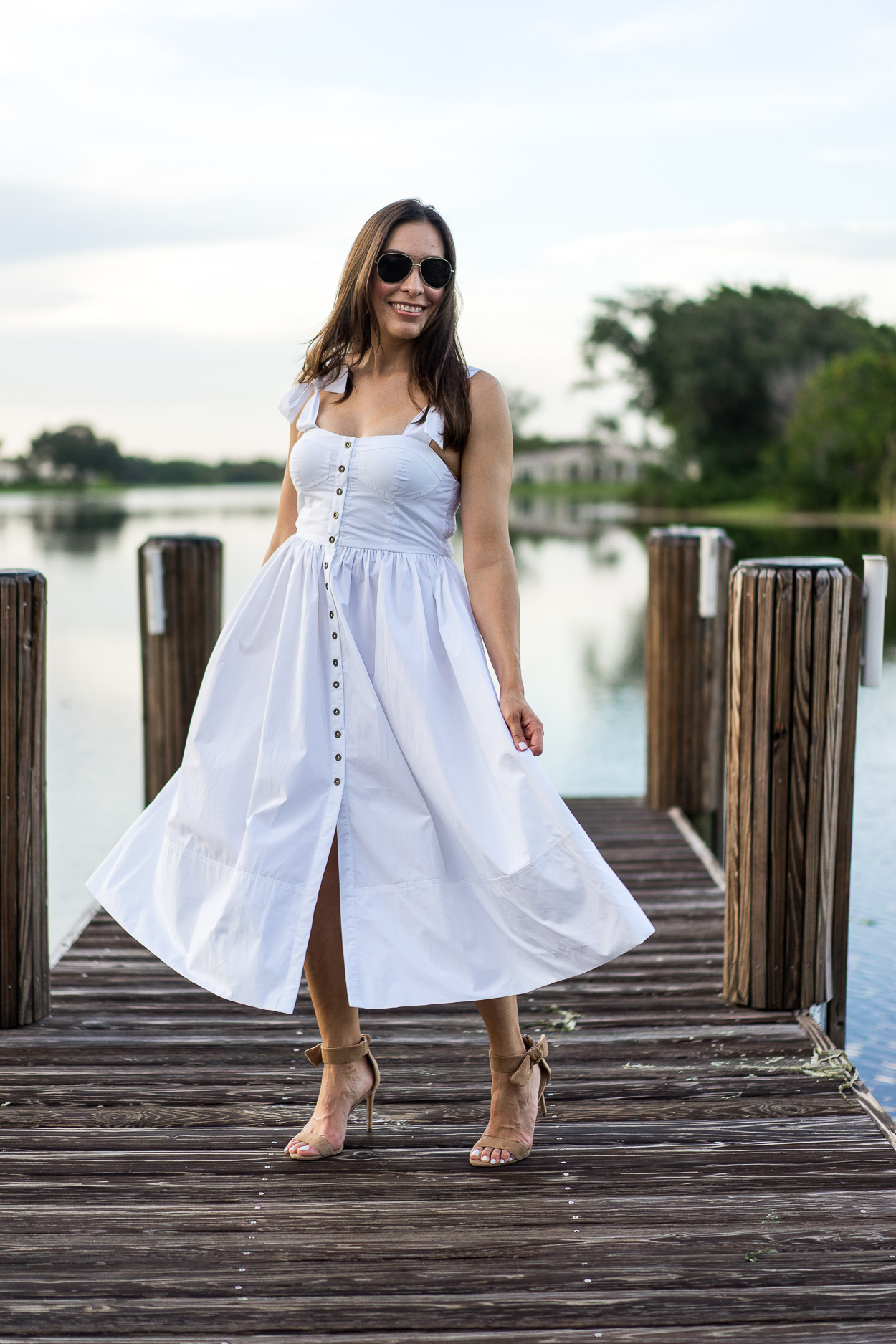 Twirl in a Summer white dress by Chicwish like South Florida blogger Amanda of A Glam Lifestyle